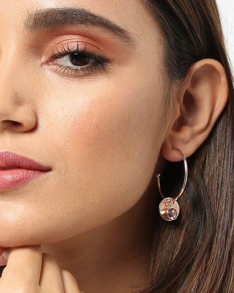 Woman in rose gold earrings